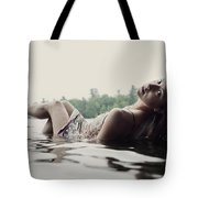 A Young Woman In A White Dress Relaxes Tote Bag
