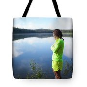 A Young Woman Looks Out Over Unna Lake Tote Bag