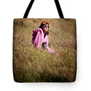 A Young Woman Sitting In A Field Tote Bag