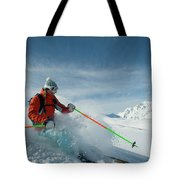 A Young Woman Skis The Backcountry Tote Bag