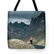 A Young Woman Takes In The View While Tote Bag