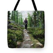 A Young Woman Walks Along An Sub-alpine Tote Bag