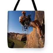 Adventure Racer Rappelling Over A River Tote Bag