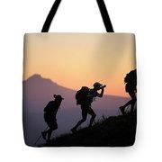Adventure Racing Team Hiking At Sunset Tote Bag