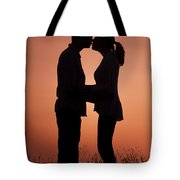 Affectionate Couple At Sunset In Profile  Tote Bag