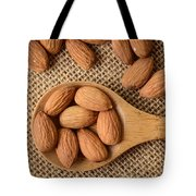 Almonds On A Spoon With Brown Background Tote Bag
