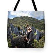 An Adventure Tourist Admires The Unique Tote Bag