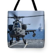 An Army Ah-64d Apache Helicopter Takes Tote Bag