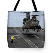 An Army Mh-47g Chinook Conducts Deck Tote Bag