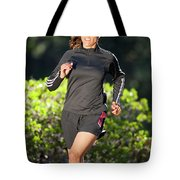 An Athletic Woman Trail Running Tote Bag