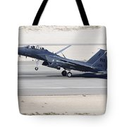 An F-15c Eagle Landing On The Runway Tote Bag