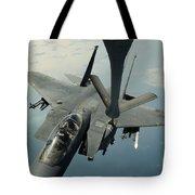 An F-15e Strike Eagle Receives Fuel Tote Bag