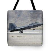 An F-22 Raptor Landing On The Runway Tote Bag