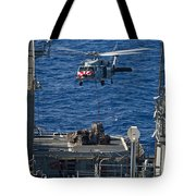 An Mh-60s Sea Hawk Delivers Supplies Tote Bag