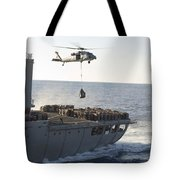 An Mh-60s Sea Hawk Helicopter Carries Tote Bag