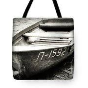 An Old Row Boat In Black And White Tote Bag