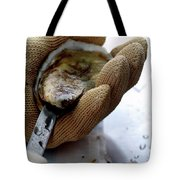 An Oytser Being Shucked Tote Bag