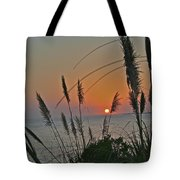 as the sun sets at Seascape Tote Bag