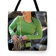 Attractive Female Climber Adjusting Tote Bag