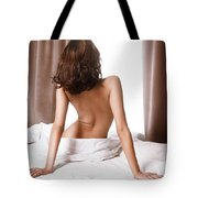 Back Of Woman Sitting Naked On Bed In Front Of Window Tote Bag