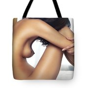 Beautiful Nude Woman Sitting On Bed With Arms Around Her Knees Tote Bag