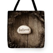 Believe In Text In The Center Of A Christmas Wreath Tote Bag