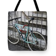 Bicycle Is Chained To A Fence Tote Bag