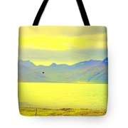 A Black Bird Is Crossing The Golden Landscape Tote Bag