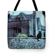 Black Cat On A Stone Wall By House Tote Bag