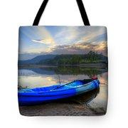 Blue Canoe At Sunset Tote Bag