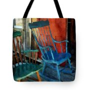 Blue Chair Against Red Door Tote Bag