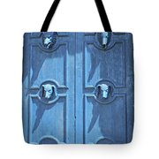 Blue Door Decorated With Wooden Animal Heads Tote Bag
