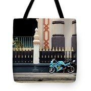 Blue Yellow Sporty Motorcycle Parked On Pavement Tote Bag