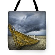 Boat On The Beach With Oncoming Storm Tote Bag
