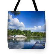 Boats At Dock On A Lake With Blue Sky Tote Bag