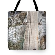 Boots On Narrow Swing Bridge Over White Water Tote Bag