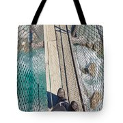 Boots On Swing Bridge Over Troubled White Water Tote Bag