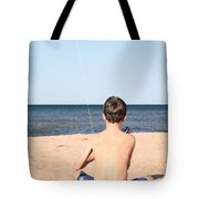 Boy At The Beach Flying A Kite Tote Bag