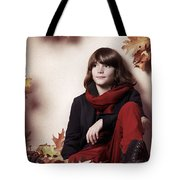 Boy Sitting On Autumn Leaves Artistic Portrait Tote Bag