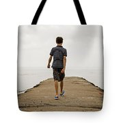 Boy Walking On Concrete Beach Pier Tote Bag