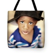 Boy Wearing Over Sized Hat Sideways Tote Bag by Ron Nickel