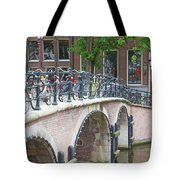 Bridge Over Canal With Bicycles  In Amsterdam Tote Bag