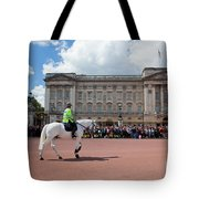 British Royal Guards Riding On Horse And Perform The Changing Of The Guard In Buckingham Palace Tote Bag