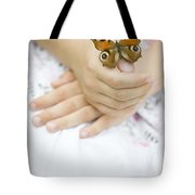 Butterfly Resting On A Girls Hand Tote Bag