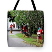 Camouflaged Leaf Blowers Working In Singapore Park Tote Bag