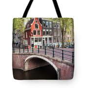 Canal Bridge And Houses In Amsterdam Tote Bag