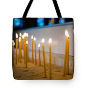 candles in the Catholic Church shallow depth of field Tote Bag