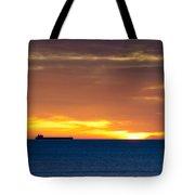 Cargo Ship On Horizon At Dawn Tote Bag