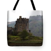 Cartoon - Structure Of The Eilean Donan Castle In Front With Dry Part Of Lake Tote Bag