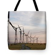 Cattle Graze In Field Next To Windmills Tote Bag